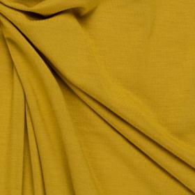 helder mosterd geel stretch tricot van bamboe