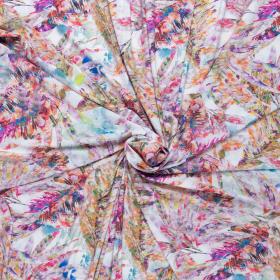wit travel met multi color bladeren print